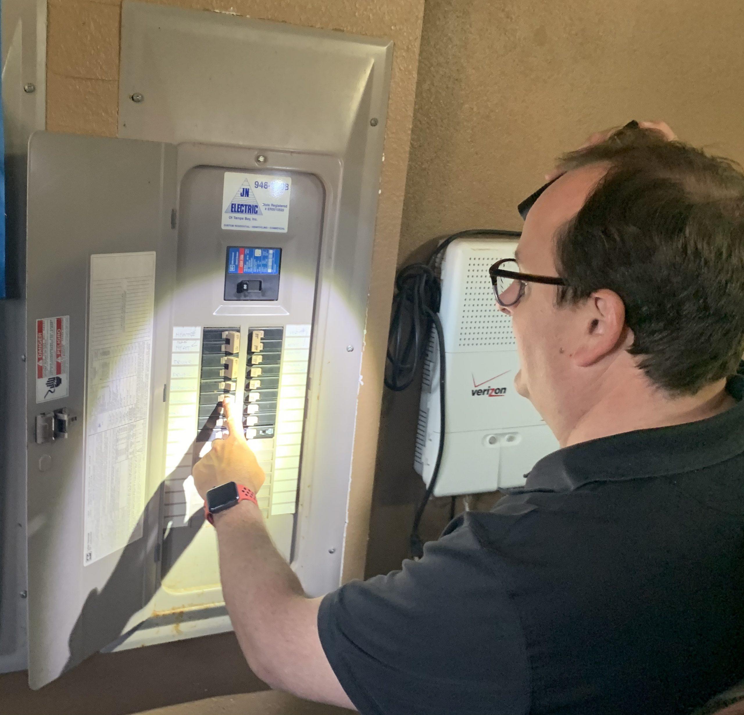 Tarpon Springs Home Watch checking breaker panel